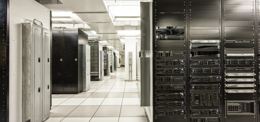Storage racks aligned in a computer server room.